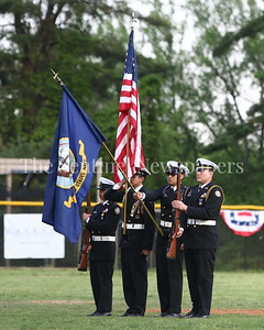 George P. Smith/The Montgomery Sentinel    Members of a Navy Junior Reserve Officers Training Corps (NJROTC) Color Guard present the colors during the playing of the National Anthem at the Walt Whitman High School's 2018 Baseball Program Community Night.