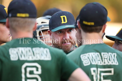 George P. Smith/The Montgomery Sentinel    Damascus High School coach is intense as he talks to his players during a pitching change.