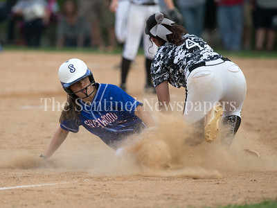 Sherwood's Ally Bloom (9) steals third base under the tag of Northwest's Karlie Stanford (4). Sherwood remains underfeated with a 5-3 win. PHOTO BY MIKE CLARK