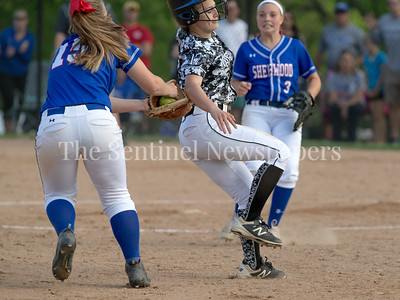 Down by two runs, Northwest base runners were forced to take late-game chances. Sherwood Third Basemen Emily Hesse tags out Northwest's Kiersten Madoo. PHOTO BY MIKE CLARK