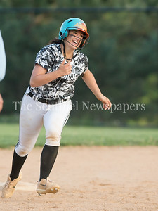 Northwest's Karlie Standord celebrates her late game 3-run home run. Northwest's comeback attempt fell short as Sherwood completed an undefeated season. PHOTO BY MIKE CLARK