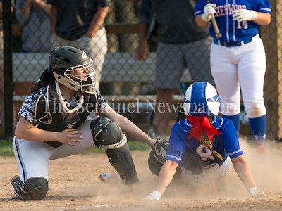 It was a close play at the plate but Sherwood's Tess Farley beats the tag by Northwest Catcher Kaylah Qassis. PHOTO BY MIKE CLARK
