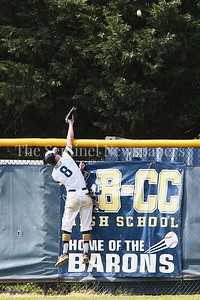 George P. Smith/The Montgomery Sentinel    Walt Whitman High School's Justin Carboni (5) put one over the right field fence that Bethesda-Chevy Chase High School's Jamie Mills (8) tried mightily to reach.