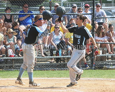 George P. Smith/The Montgomery Sentinel    Walt Whitman High School's Jack Ryan (9) congratulates Justin Carboni (5) after he hit a home run.