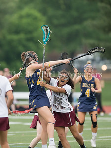 Julia Gilbert of Bullis gets this shot off dispite the fierce Sidwell Friends defense. Bullis mounted a 9-0 lead when play with stopped with a Tornado warning. PHOTO BY MIKE CLARK
