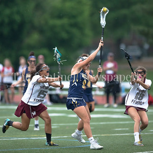 Halle Magruder of Bullis takes aim and fires this first half goal after splitting the Sidwell Friends defenders. PHOTO BY MIKE CLARK