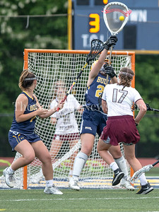Olivia Kazanjian of Bullis stops Maisey Biden's shot and shutsout the Sidwell Friends offense during the first half of the rain-shortened game. PHOTO BY MIKE CLARK