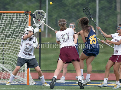 Sarah Labovitz (25) of Bullis splits Sidwell Friends defenders Maisey Biden (17) and Nina McCormack (12) to fire this first half goal. PHOTO BY MIKE CLARK