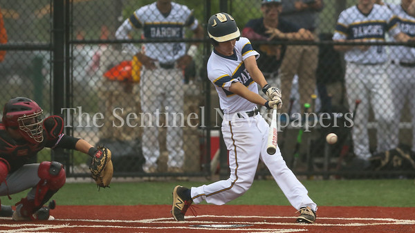 Bethesda-Chevy Chase Barons' Drew Packs hits an RBI single to tie the game at 1-1. It would take eight innings to earn the Baron Regional Championship. PHOTO BY MIKE CLARK