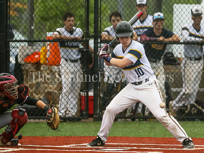 Bethesda-Chevy Chase's Nils Townsend eyes this low ball just before hitting the game winning double in the bottom of the eighth inning. Townsend's hit earns BCC it's first Regional Finals win since 1989. PHOTO BY MIKE CLARK
