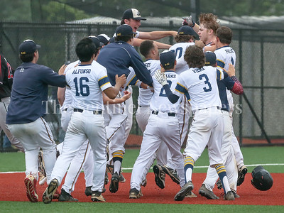 The Bethesda-Chevy Chase bench clears to congratulate Nils Townsend, who's eigth inning gaming winning double takes BCC to the state semi-finals. PHOTO BY MIKE CLARK