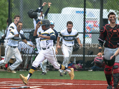 Bethesda-Chevy Chase's Austin Taylor crosses the plate to score the winning run against Quince Orchard. Nils Townsend drove Taylor in with a game winning double. BCC won it's first Regional Finals win since 1989. PHOTO BY MIKE CLARK