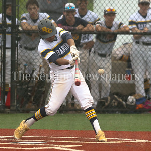 Bethesda-Chevy Chase Barons'  Austin Taylor gets on base with this single and later scores the winning run on Nils Townsend's eigth inning RBI double. PHOTO BY MIKE CLARK