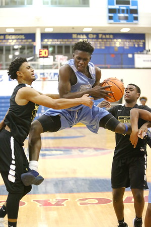 George P. Smith/The Montgomery Sentinel     Springbrook High School's Siaka Ceesay Sr. (34) pulls down a big rebound against Oxon Hill High School at the Capitol Hoops Summer League played at DeMatha High School at 9:15PM on Thursday  night, May 31, 2018.