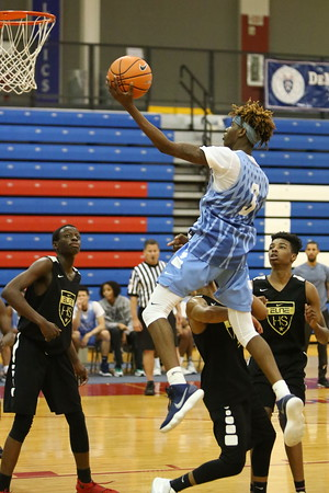 George P. Smith/The Montgomery Sentinel     Springbrook High School's Timitrius Hawkins (3) drives to the basket against Oxon Hill High School at the Capitol Hoops Summer League played at DeMatha High School at 9:15PM on Thursday  night, May 31, 2018.