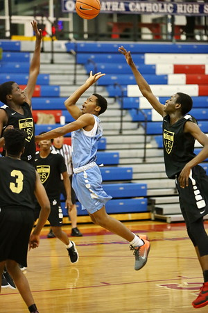 George P. Smith/The Montgomery Sentinel     Springbrook High School's Kam'ron Simmons (24) drives to the basket against Oxon Hill High School at the Capitol Hoops Summer League played at DeMatha High School at 9:15PM on Thursday  night, May 31, 2018.