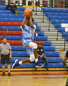George P. Smith/The Montgomery Sentinel    Springbrook High School's Timitrius Hawkins (3) takes a running shot from the side of the key against Oxon Hill High School at the Capitol Hoops Summer League played at DeMatha High School at 9:15PM on Thursday  night, May 31, 2018.