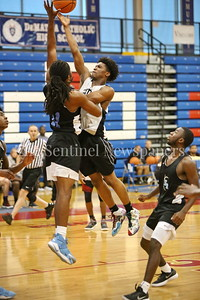 George P. Smith/The Montgomery Sentinel   Paint Branch High School's Jordan Alphonso (20) shoots over Eleanor Roosevelt High School's Brandon Thomas (11) during the Capitol Hoops Summer League game  played at DeMatha High School on Sunday, June 3, 2018.