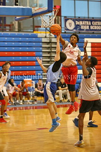 George P. Smith/The Montgomery Sentinel    St. John's College High School's Devon Dunn (2) blocks the shot by Walt Whitman High School's Jaden Pierce (11) during the Capitol Hoops Summer League game  played at DeMatha High School on Sunday, June 3, 2018.