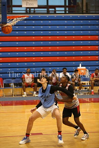 George P. Smith/The Montgomery Sentinel    Walt Whitman High School's Rodrigo Ruiz (24) boxes out St. John's College High School's Devon Savage (10) during the Capitol Hoops Summer League game  played at DeMatha High School on Sunday, June 3, 2018.