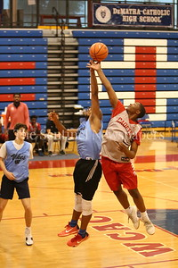 George P. Smith/The Montgomery Sentinel    Walt Whitman High School's Bert Tillett (87) battles  St. John's College High School's Saveon Jackson (12) for a rebound during the Capitol Hoops Summer League game  played at DeMatha High School on Sunday, June 3, 2018.