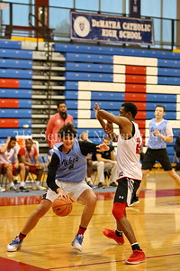 George P. Smith/The Montgomery Sentinel     Walt Whitman High School's Rodrigo Ruiz (24) posts up against  St. John's College High School's Victory Naboya (24) during the Capitol Hoops Summer League game  played at DeMatha High School on Sunday, June 3, 2018.