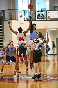 George P. Smith/The Montgomery Sentinel    Walt Whitman High School's Rodrigo Ruiz (24) beats St. Johns Victory Naboya (24) at the tip off during the Capitol Hoops Summer League game  played at DeMatha High School on Sunday, June 3, 2018.