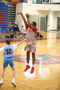 George P. Smith/The Montgomery Sentinel     St. John's College High School's Casey Morsell (14) shoots a three over Walt Whitman High School's Sean Farren (12) during the Capitol Hoops Summer League game  played at DeMatha High School on Sunday, June 3, 2018.