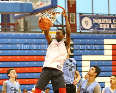 George P. Smith/The Montgomery Sentinel    St. John's College High School's Victory Naboya (24) with the dunk against Walt Whitman High School during the Capitol Hoops Summer League game  played at DeMatha High School on Sunday, June 3, 2018.