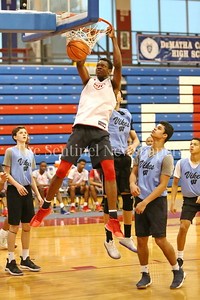 George P. Smith/The Montgomery Sentinel     St. John's College High School's Victory Naboya( 24) with the dunk against Walt Whitman High School during the Capitol Hoops Summer League game  played at DeMatha High School on Sunday, June 3, 2018.