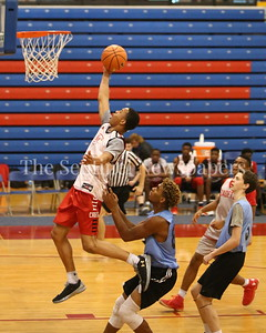 George P. Smith/The Montgomery Sentinel     St. John's College High School's Darius Maddox (4) beats Walt Whitman High School's Bert Tillett (87) and Jay McClelland (5) down the court in transition during the Capitol Hoops Summer League game  played at DeMatha High School on Sunday, June 3, 2018.