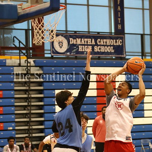 George P. Smith/The Montgomery Sentinel     St. John's College High School's Ishmael Leggett (5) takes it to the hoop over Walt Whitman High School's Rodrigo Ruiz (24) during the Capitol Hoops Summer League game  played at DeMatha High School on Sunday, June 3, 2018.