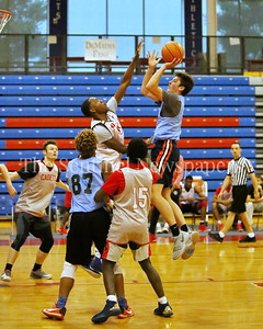 George P. Smith/The Montgomery Sentinel    Walt Whitman High School's Brendan Shaver (3) shoots over  St. John's College High School's Josh Paige (40) during the Capitol Hoops Summer League game  played at DeMatha High School on Sunday, June 3, 2018.