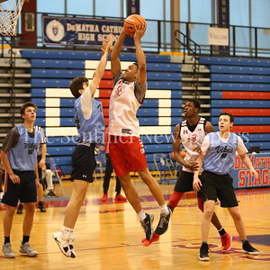 George P. Smith/The Montgomery Sentinel    St. John's College High School's Ishmael Leggett (5) shoots over Walt Whitman High School's Rodrigo Ruiz (24) during the Capitol Hoops Summer League game  played at DeMatha High School on Sunday, June 3, 2018.