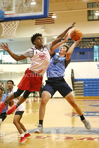 George P. Smith/The Montgomery Sentinel    St. John's College High School's Devon Dunn (2) tries to block the shot by Walt Whitman High School's Brendan Shaver (3) during the Capitol Hoops Summer League game  played at DeMatha High School on Sunday, June 3, 2018.