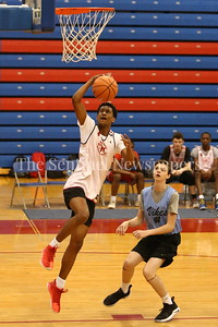 George P. Smith/The Montgomery Sentinel    St. John's College High School's Darius Maddox (4) beats Walt Whitman High School's Jay McClelland (5) to the hoop during the Capitol Hoops Summer League game  played at DeMatha High School on Sunday, June 3, 2018.