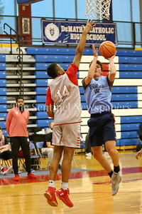 George P. Smith/The Montgomery Sentinel    Walt Whitman High School's Brendan Shaver (3) pops a jumper in front of St. John's College High School's Casey Morsell (14) during the Capitol Hoops Summer League game  played at DeMatha High School on Sunday, June 3, 2018.