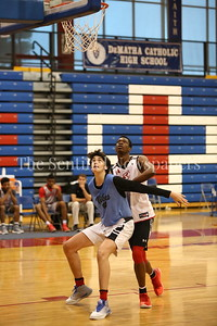 George P. Smith/The Montgomery Sentinel    Walt Whitman High School's Rodrigo Ruiz (24) boxing out  St. John's College High School's Victory Naboya (24) during the Capitol Hoops Summer League game  played at DeMatha High School on Sunday, June 3, 2018.
