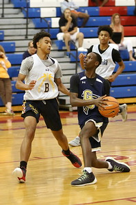 George P. Smith/The Montgomery Sentinel    Good Counsel's Bez Mbeng (11) going for the hoop as Bullis School's Rodney Rice (5) tries to block during the Capitol Hoops Summer League game played Saturday, June 9, 2018 at DeMatha Catholic High School.