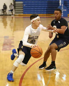George P. Smith/The Montgomery Sentinel    Bullis School's Cole Hanin (11) shoots over Good Counsel's Justin Graham (27) during the Capitol Hoops Summer League game played Saturday, June 9, 2018 at DeMatha Catholic High School.