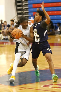 George P. Smith/The Montgomery Sentinel    Good Counsel's Antoine Jack (7) defends against Bullis School's Kolin Lewis (3) during the Capitol Hoops Summer League game played Saturday, June 9, 2018 at DeMatha Catholic High School.