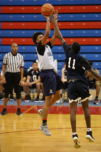 George P. Smith/The Montgomery Sentinel    Bullis School's Alex Caldeira (2) shoots over Good Counsel's Bez Mbeng (11) during the Capitol Hoops Summer League game played Saturday, June 9, 2018 at DeMatha Catholic High School.