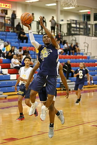 George P. Smith/The Montgomery Sentinel    Good Counsel's Bryce Walker (22) taking it to the hoop during the Capitol Hoops Summer League game played Saturday, June 9, 2018 at DeMatha Catholic High School.