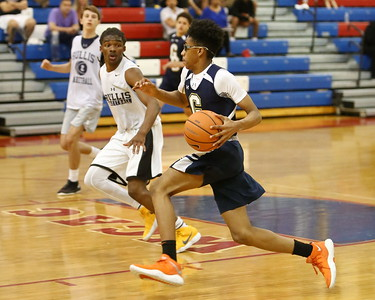 George P. Smith/The Montgomery Sentinel    Good Counsel's RJ Floyd (44) drives past Bullis School's Kolin Lewis (3) during the Capitol Hoops Summer League game played Saturday, June 9, 2018 at DeMatha Catholic High School.