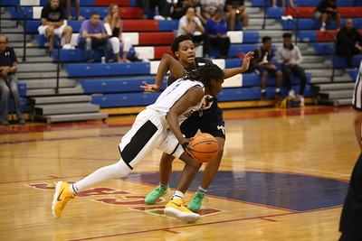 George P. Smith/The Montgomery Sentinel    Bullis School's Kolin Lewis (3) drives past Good Counsel's Antoine Jacks (7) during the Capitol Hoops Summer League game played Saturday, June 9, 2018 at DeMatha Catholic High School.