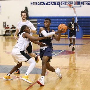 George P. Smith/The Montgomery Sentinel    Good Counsel's Bryce Walker (22) taking it to the hoop past Bullis School's Kolin Lewis (3)  during the Capitol Hoops Summer League game played Saturday, June 9, 2018 at DeMatha Catholic High School.