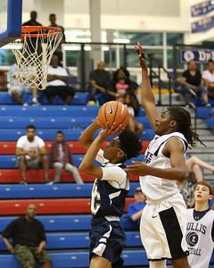 George P. Smith/The Montgomery Sentinel    Bullis School's Kolin Lewis (3) about to lower the boom on Good Counsel's RJ Floyd (44) during the Capitol Hoops Summer League game played Saturday, June 9, 2018 at DeMatha Catholic High School.