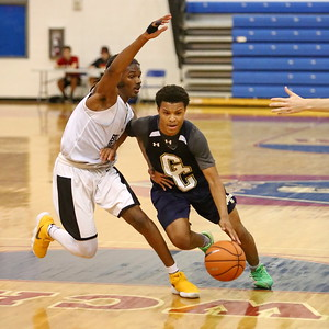 George P. Smith/The Montgomery Sentinel    Good Counsel's Antione Jacks (7) drives past Bullis School's Kolin Lewis (3) during the Capitol Hoops Summer League game played Saturday, June 9, 2018 at DeMatha Catholic High School.