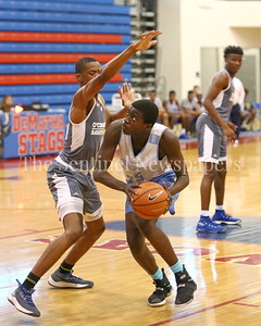 George P. Smith/The Montgomery Sentinel    Springrook High School's Daouda Dembele (25) starts his post move on Bishop O'Connell High School's Theodore Gadsden, Jr. during  the Capitol Hoops Summer League game played at DeMatha High School Friday, June 15, 2018.