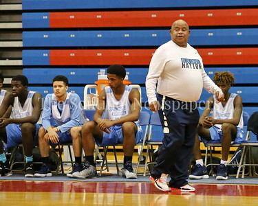 George P. Smith/The Montgomery Sentinel    Springbrook Head Coach Darnell Myers sporting his Blue Devil Nation t-shirt during the Capitol Hoops Summer League game played at DeMatha High School Friday, June 15, 2018.